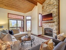 family room with mountain views gas fireplace and flatscreen tv