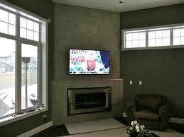 for this tv install doyle used a zero clearance tiltable wall mount bracket with mounted the tv just over 1 2 inch from the wall and allowed it to tilt just