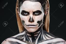closeup of young woman with terrifying skeleton makeup over black background stock photo 63163749