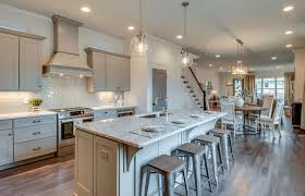 Open concept kitchen with tundra gray marble counter