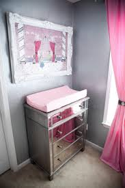 LOVE the idea of a mirror by the changing table- mirrors always seem to make