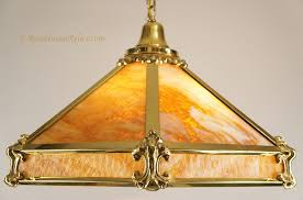 large cast brass and slag glass chandelier circa 1910s