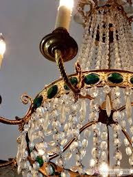 striking jewel like details of the antique crystal chandelier enchant and captivate