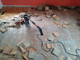 floor stripper removing parquet from plywood floor
