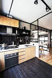 industrial kitchen furniture. Captivating Industrial Kitchen Furniture Black Floor Tiles Wooden Cabinets Back Wall