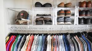 a man s professionally organized closet on long island