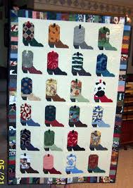 Cowboy/girl quilt- do this but,in cute colors and patterns ... & Quilts and a Mug: Memories from a cowboy boot quilt Adamdwight.com