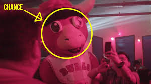 chance the rapper dressed as benny the bull at his magnificent coloring world party