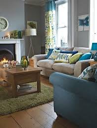 I can envision something like this in your living room - the beige sofa,  blue/green pillows, the wooden coffee table, and some more colorful accent