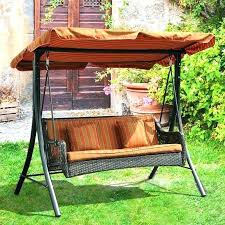 outdoor glider canopy swing with in green white colour by patio clearance polished rod iron wooden