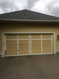 winsome can i manually open my garage door with a broken spring