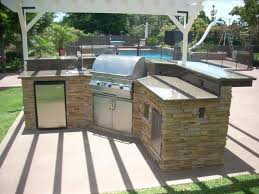 cinder block outdoor kitchen storage solutions with top rated appliances and concrete floor for fabulous backyrd with small swimming pool