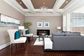 brownish grey living room contemporary with bright blue throw pillow chandeliers