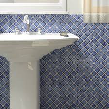 this somertile 12 5 x 12 375 inch antaeus sapphire porcelain mosaic floor and wall tile is cobalt blue with a slightly faded edge and high gloss sheen