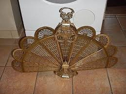vintage ornate brass fireplace folding peacock fan screen art deco