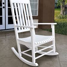 white wood porch rocking chair on patio