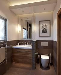 kleines badezimmer trennwand waschkonsole holz toilette braun ...
