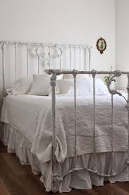 Need to paint my iron bed white for the spare room and then layer it with
