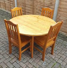 solid pine dining table with 4 pine chairs round furniture in excellent condition just
