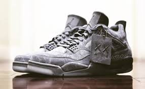 jordan grey. a kaws x air jordan 4 collaboration was first rumored in january, and we now have look at the cool grey, grey 0