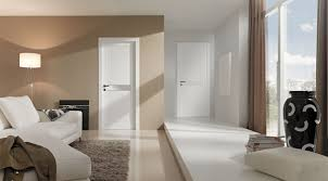 modern interior doors design. Sumptuous White Painted Modern Interior Doors With Chrome Panels As Decorate Family Room Designs Added Sofa Over Grey Rugs Decors Design E