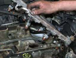 fuel injection system basics how fuel injections work 1a auto closeup of a fuel injector rail