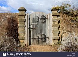 sy old wooden garden gate with no entry sign and large br hinges sus england