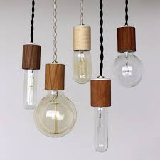 above onefortythree s wood veneered pendant lights are 40 each the is taking new orders starting october 20 2016
