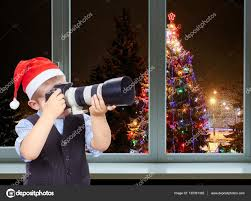 Photographing Christmas Tree Lights The Boy Is Photographing On The Camera On A Background