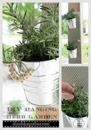 Create a DIY hanging herb garden inexpensively for under $10. Featured on  Ella Claire Inspired