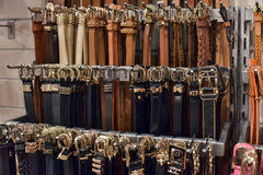 Large variety of leather belts. In store Stock Photos