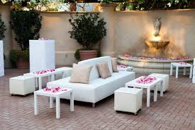 outdoor wedding furniture. white furniture with pink rose petal decorations outdoor wedding r