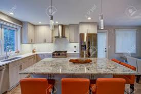 ivory kitchen cabinets. Gorgeous Kitchen Design Features Ivory Cabinets Flanking Modern Steel Hood, Linear Marble Tile G