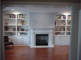 enchanting built in white living room storage cabinets with bottom wooden door cabinet and upper open shelving plus elegant center fireplace