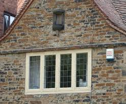 tudor style architecture exterior  Arts and crafts timber casement window