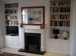 fireplace with ed alcove cupboard cabinet shelvese cupboards