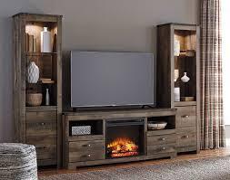 trinell entertainment center w fireplace signature design furniture cart