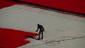 painting a tin roof stock footage 7500124 shutterstock