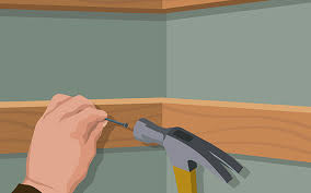 this picture shows you how to hammer in the bottom supports for your diy closet organizer