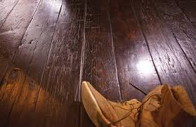or has dirt build up work area with wax using fine steel wool to remove grime and old wax wipe the floor clean let it dry for about 30 minutes