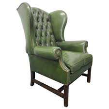 vintage green leather tufted wingback chair for