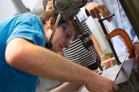 Rice University Freshman Michael Young Prepares To Drill A Part In The  Machine Shop At The Oshman Engineering Design Kitchen. The Student And His  Teammates ...