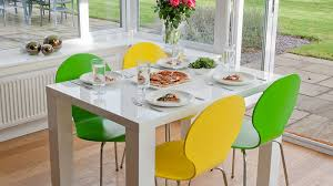 small white gloss dining table and white dining chairs