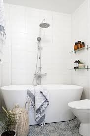 freestanding bathtubs for small spaces. a very small bathroom with patterned grey tile floor and freestanding tub for bathtubs spaces g