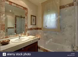 Modern Marble Bathroom Glass Shower Screen On Bath In Modern Marble Bathroom With Voile