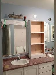 update bathroom mirror: large bathroom mirror redo to double framed mirrors and cabinet bathroom ideas home decor shelving ideas middle cabinet in place new light fixtures