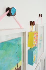 an easy way to personalize round wood hooks by young house love on