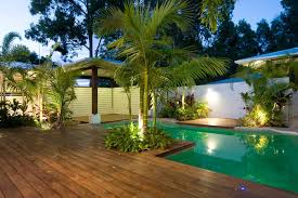 tropical outdoor lighting. alfresco decking ideas pool tropical with wood deck outdoor entertaining shaped concrete lighting r