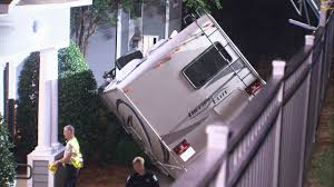 CAMPER ALMOST HIT APARTMENTS: POLICE: Camper drove through fence ...