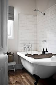 I've seen a lot of clawfoot tubs with subway tile accent wall(s). Some clawfoot  tubs are painted black. Maybe the grey tile floor, white subway tile, ...